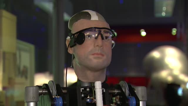 Interior shots one million dollar bionic man sitting in chair operator turning knobs making bionic man move head Bionic Man Moving Head at Science...
