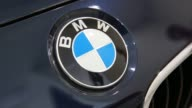 Interior shots pan across the showroom floor of a BMW Dealership in Mexico City Mexico A customer sits in the drivers seat of a BMW and tests the...