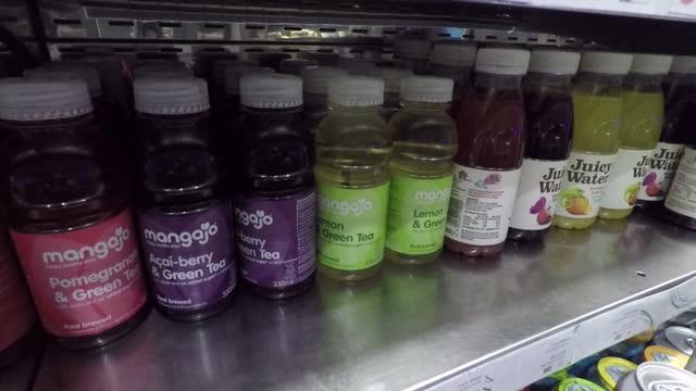 Interior shots plastic bottles of fruit juice being taken from shelves single use plastics on November 16 2017 in London England