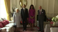 Interior shots President Barack Obama and Michelle Obama First Lady walk into the Oak Room at Windsor Castle for photocall with Queen Elizabeth II...