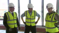 Interior shots Prime Minister David Cameron leader of Conservative Party on walkabout at TPP building site in Horsforth wearing hardhat and high viz...