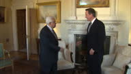 Interior shots Prime Minister David Cameron Palestinian Prime Minister Mahmoud Abbas walk into Number 10 Downing Street room pose for the press...