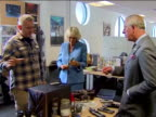 Interior shots Prince Charles and Camilla looking at Dr Who props and both holding the Dr's sonic screwdriver Prince Charles And Camilla With Dr Who...