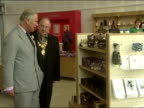 Interior shots Prince Charles Camilla Duchess of Cornwall look around the Heartlands Visitor Centre gift shop during a visit to Cornwall Charles...