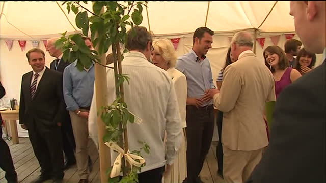 Interior shots Prince Charles Camilla meeting guests at River Cottage Camilla talking to Hugh FearnleyWhittingstall on July 15 2014 in Axminster...