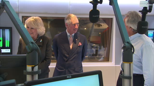 Interior shots Prince Charles Prince of Wales and Camilla Duchess of Cambridge on tour of Global Radio Headquarters being shown Classic FM radio...