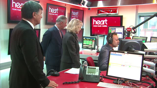 Interior shots Prince Charles Prince of Wales and Camilla Duchess of Cambridge on tour of Global Radio Headquarters being shown Heart FM radio...