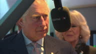 Interior shots Prince Charles Prince of Wales and Camilla Duchess of Cambridge on tour of Global Radio Headquarters talking with radio DJ John Suchet...