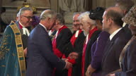 Interior shots Prince Charles Prince of Wales meet and greet church members next to the Very Reverend John Hall Dean of Westminster smiling at...