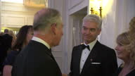 Interior shots Prince Charles Prince of Wales meeting and talking with Philip Schofield at Prince's Trust Charity Event on in London England