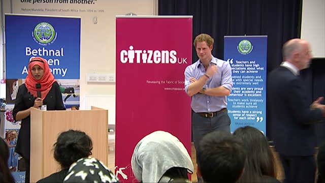 interior shots Prince Harry enters assembly hall and stands behind podium