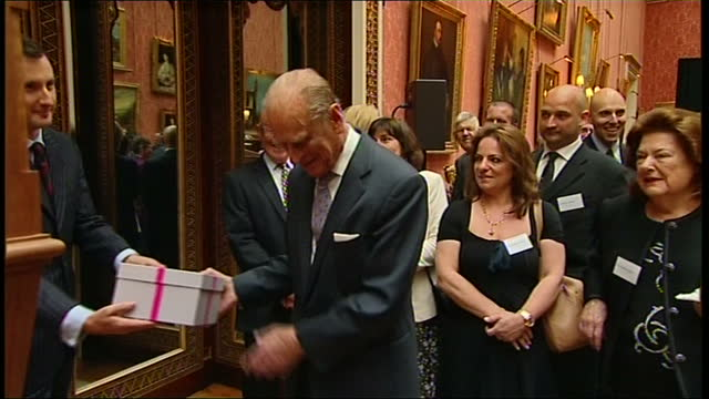 Interior shots Prince Philip opening a pair of headphones making a joke about if he can pick up Radio 3 on them Intrior shots Prince Philip is given...