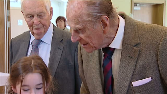 NORFOLK Interior shots Prince Philip watching over children drawing at table