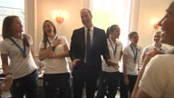 Interior shots Prince William Duke of Cambridge laughing and joking with members of the England Woman's Football Team at Kensington Palace on July 09...