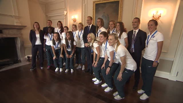 Interior shots Prince William Duke of Cambridge standing for photo with members of the England Woman's Football Team at Kensington Palace on July 09...