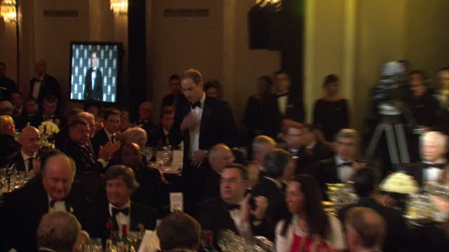 Interior shots Prince William Duke of Cambridge takes his seat at table after giving speech at gala dinner for 150 years of the FA Prince William...