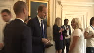 Interior shots Prince William Duke of Cambridge talking with Mark Sampson Manager and Toni Duggan player during visit by England Womans Football Team...