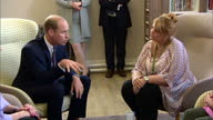 Interior shots Prince William sits in armchair and speaks to group of women