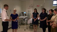 Interior shots Prince William taling with line of hospital staff Nurses Healthcare assistants air ambulance paramedics