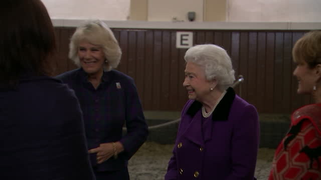Interior shots Queen Elizabeth II and Camilla Duchess of Cornwall talking with Monty Roberts and other guests after Horse Whispering demonstration on...