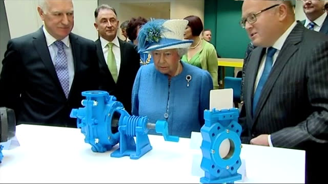 Interior shots Queen Elizabeth II being shown items on display designed by students whilst on visit to Strathclyde University Research Centre on July...