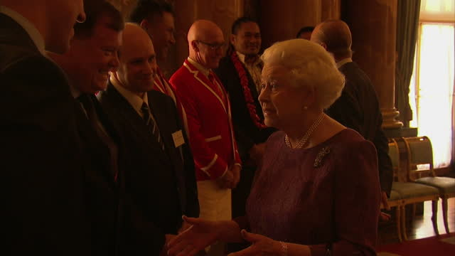 Interior shots Queen Elizabeth II meeting world rugby players and coaches at Rugby World Cup reception at Buckingham Palace on October 12 2015 in...