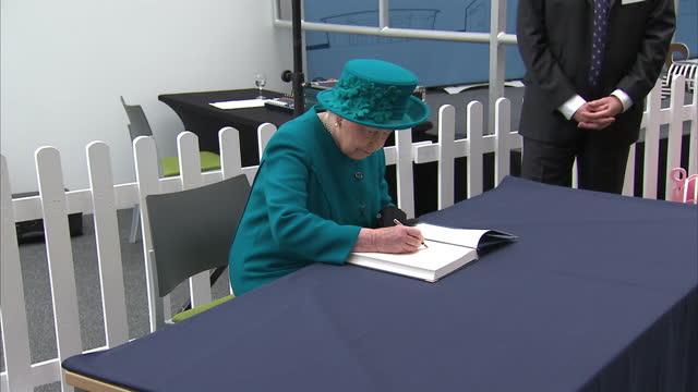 Interior shots Queen Elizabeth II signs guest book after opening the New School of Veterinary Medicine at the University of Surrey on October 15 2015...