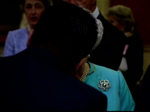 Interior shots Queen Elizabeth II talking with commonwealth dignitaries at CHOGM reception Queen Elizabeth II hosts Commonwealth Heads Of Government...