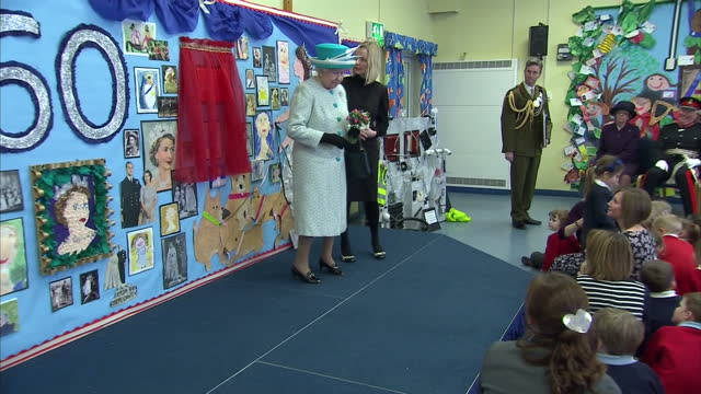 Interior shots Queen Elizabeth II unveils plaque at Dersingham School Norfolk Today marks the 60th anniversary of the Queen's accession to the throne...