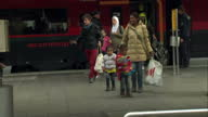 Interior shots refugees migrants asylum seekers arriving at Munich train station AUDIO locals cheering welcoming refugees on September 05 2015 in...