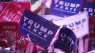 Interior shots Republican supporters at Donald Trump rally holding up signs reading 'Trump Pence' and 'Make America Great Again' on August 25 2016 in...