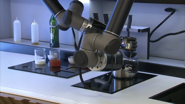 Interior shots robots cooking during robotic kitchen demonstration at Shadow Robot Laboratory on September 02 2015 in London England