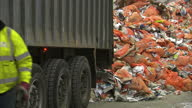 Interior shots rubbish dustbin truck dumps wate onto pile of refuse rubbish at Biffa Waste Services Edmonton Rubbish Dumping at Edmonton on September...