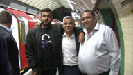Interior shots Sadiq Khan London Mayor walks along London Underground platform talking with people and stopping to pose for selfies on first night of...