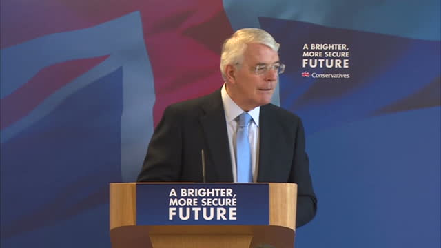 Interior shots Sir John Major Former Prime Minister walking to podium to address delegates in Solihull on April 21 2015 in Solihull England