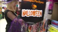 Interior shots Tesco employees dressed up in Halloween fancy dress and sorting shelves on October 14 2014 in London England
