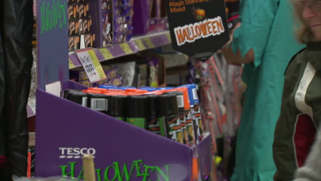 Interior shots Tesco staff dressed up in fancy dress and organising Halloween items on October 14 2014 in London England