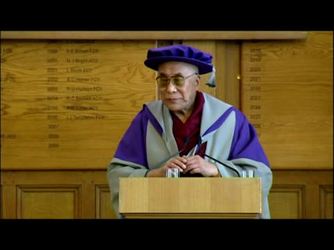 Interior shots the Dalai Lama making acceptance speech after receiving Honorary Doctorate of Philosophy from London Metropolitan University