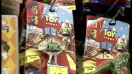 Interior shots Toys R Us employee putting Toy Story figures onto shelves on December 13 1996 in London England