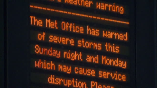 Interior shots train station departure board with severe weather warning messages being displayed Huge Storm Forecast To Hit UK on October 27 2013 in...