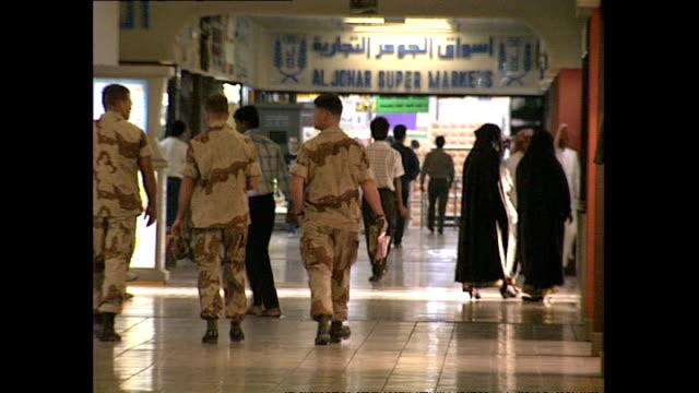 Interior shots US Army American soldiers shopping inside Riyadh shopping centre on November 16 1990 in Jeddah Saudi Arabia