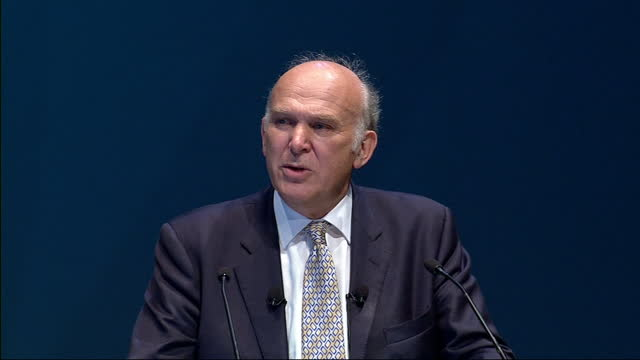 Interior shots Vince Cable addressing the Liberal Democrats Conference delivering an attack on capitalism corporate greed Nice Cable launches attack...