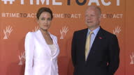 Interior shots William Hague Foreign Secretary and Angelina Jolie actress and UN Envoy posing for photographs before Global summit on rape and sexual...