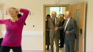 NORFOLK Interior shots women dancing in Zumba fitness class Prince Philip walks in and watches from back