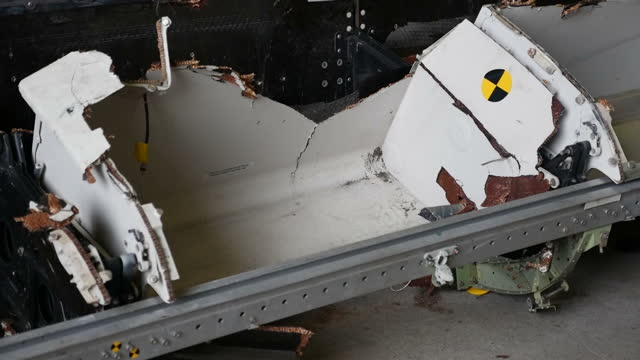 Interior shots wreckage of Malaysia Airlines flight MH17 plane laid out in hangar on GilzeRijen airbase on March 03 2015 in Gilze Netherlands