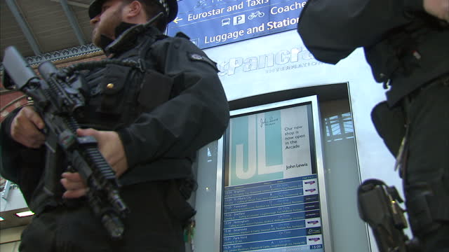Interior shows armed police on patrol in London's King's Cross St Pancras Station on January 08 2015 in London England