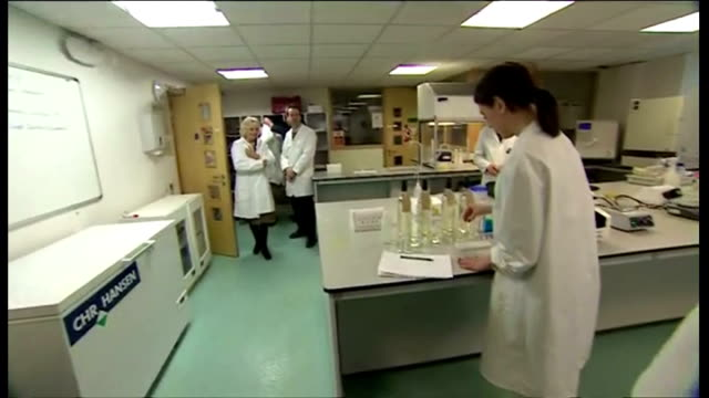 Interior shows Camilla Duchess of Cornwall in laboratory Camilla in white lab coat speaks to student on March 20 2014 in Plumpton England