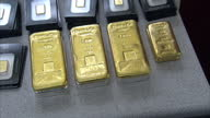 Interior shows gold bricks bullion on display Gold bars marked with weight and serial numbers