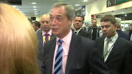 Interior shows Nigel Farage on meet and greet with Ukip delegates Leader meets with young supporter at Doncaster Racecourse on September 29 2014 in...