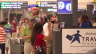 Interior shows passengers waiting in seats and queueing at desks in Dulles International Airport at Dulles International Airport on October 06 2014...
